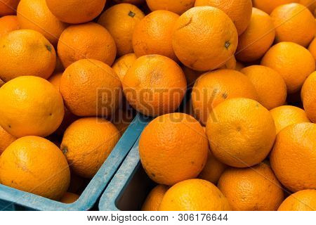Heap Of Orange Fruits At The Market Stall