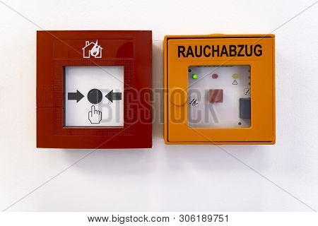 Fire Alarm System On The Wall In A Office Building. Rauchabzug In German Language Means Smoke Flue