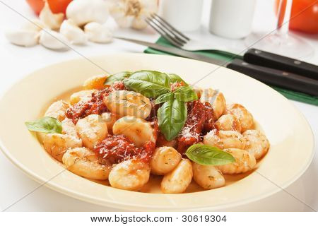 Gnocchi di patata, italian potato noodle with tomato sauce and basil