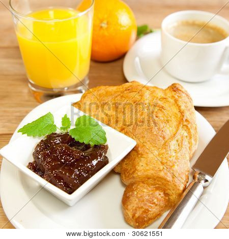 Continental breakfast with croissants