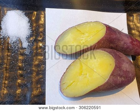 Top View Of Baked Sweet Potato With Salt On White Paper In Black Plate, Yaki Imo Is Japanese Traditi