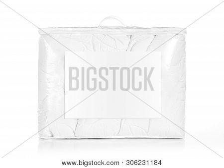 White Duvet In The Bag Isolated. Duvet Packed In To The Pvc Bag.