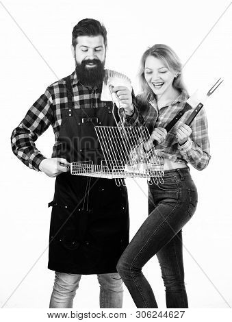 Perfect For Ourdoor Picnic. Bearded Man And Cute Girl Holding Cooking Grate With Handle. Happy Coupl