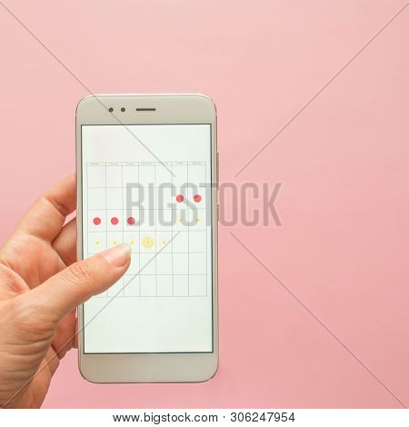 Mobile Application To Track Your Menstrual Cycle And For Marks. Pms And The Critical Days Concept. P