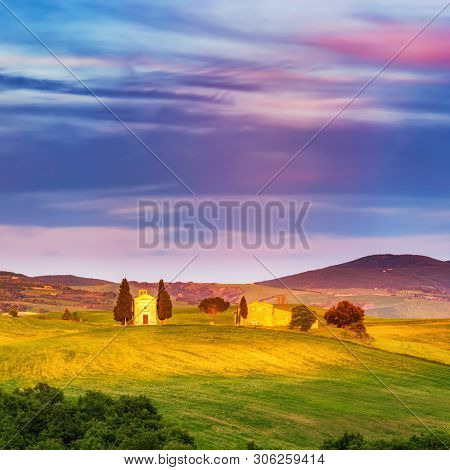 Beautiful landscape with chapel in Tuscany at sunset