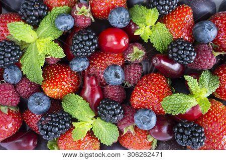 Ripe Strawberries, Raspberries, Black Berry; Red Berries, Plum And Bleberries. Top View. Red And Blu