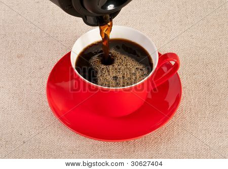 Red Coffee Cup Filled With Black Expresso