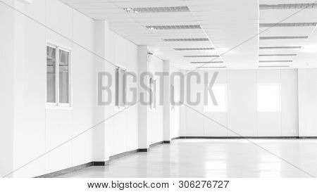 Empty Room And Office Concept - Empty White Office Space Room In Office Building Or Factory With Win