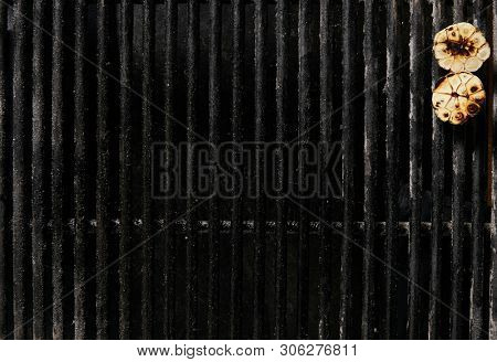 Old Empty Barbecue Grill Texture with a Thick Layer of Soot and Carbon. Dirty Iron Bbq Lattice Background Top View with Place for Text. Dark Key Photo Template for Product Advertising