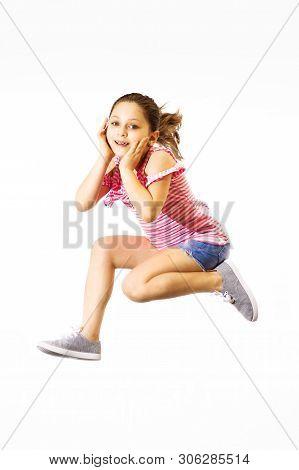 Little Jumping Caucasian Girl On White Background