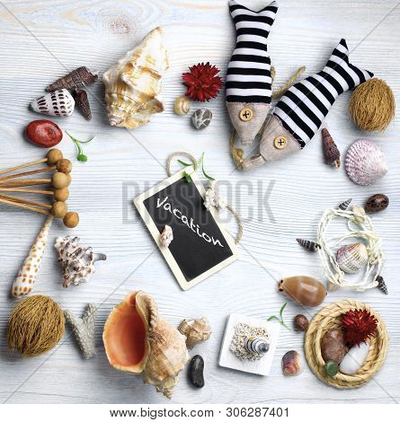 Summer Vacations Concept With Handmade Decorations, Various Shells, Dry Plants  And Chalk Board With