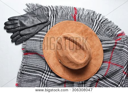 Felt Hat, Gloves On The Scarf On A White Background. Top View