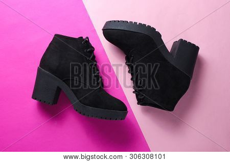 Black Suede Boots On A Two-ton Pink Background. Top View