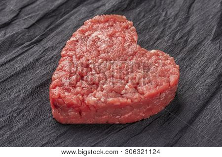 Beautiful Juicy Meat Cutlet On A Contrasting Black Background