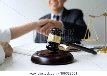 Lawyer Or Judge  With Gavel And Balance Handshake With Client Or Customer About Agreement How To  Us