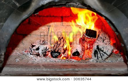 flaming wood in home fireplace