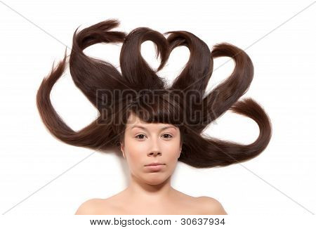 Making decoration with long brown hair