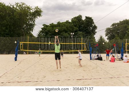 Moscow. Russia. 12 June 2019. Beach Volleyball. People Play Volleyball On The Sand In The City Park.