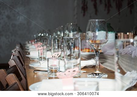 Empty Glasses In Restaurant. Cutlery On The Table In A Restaurant Table Setting, Knife, Fork, Spoon,