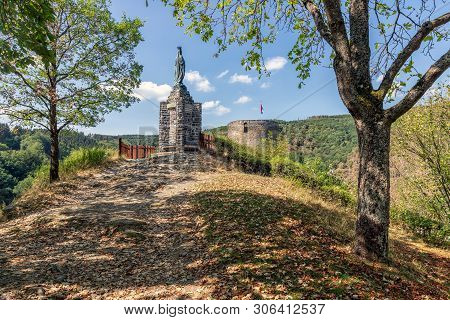 Ardennes Hill With Memorial Statue And Old Ruin Near Village Esch-sur-sure In Luxembourg