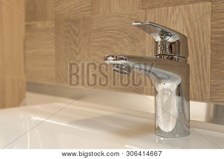 Water Faucet, Bathroom Faucet And Kitchen Faucet. Chrome-plated Metal. Close Up
