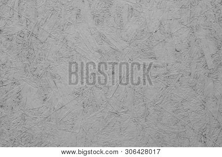 Painted osb plate carpentry chipboard panel plywood sawdust, background texture structure. Pressed wood chip surface poster
