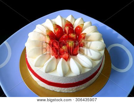 Mouthwatering Fresh Strawberry Vanilla Short Cake On Blue Ceramic Tray