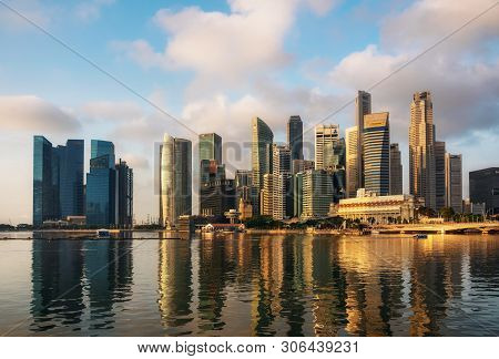 Singapore,singapore May 9 2016 : Singapore Business District With Skyscrapers And Reflection At Mari