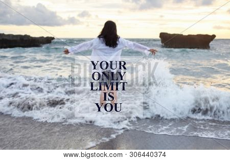 Inspirational Motivational Quote- Your Only Limit Is You. With Blurry Image Of Young Woman Standing