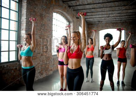 Women doing exercises on a fitness class.