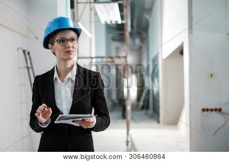Woman engineer with a blueprints