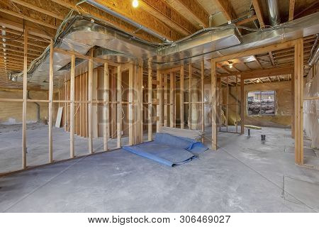 House Interior Under Construction With Air Conditioning Ducts On The Ceiling