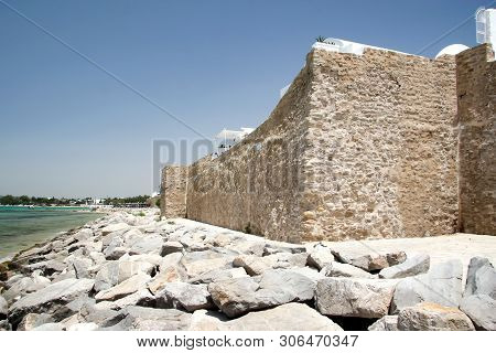 Stone Wall Of The Fortress In Hammamet, On The Shores Of The Mediterranean Sea. Tunisia