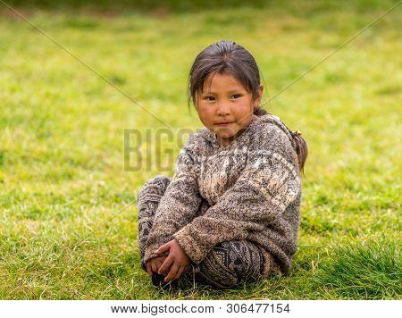 Cuzco, Peru - April 30, 2019. A Peruvian Kid Pose For Photo At A Local School