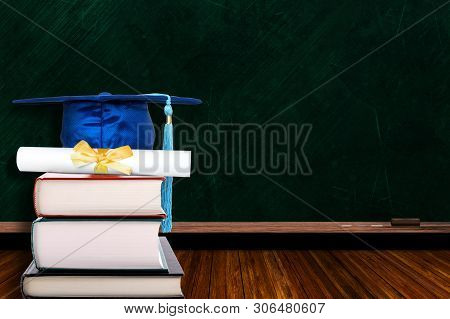 Education Concept With Blue Graduation Hat And Diploma On Stack Of Books On Blackboard Background. C