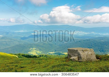 Landscape With Grassy Meadow With Giant Boulders On The Slope Of A Hill In Carpathian Mountain Ridge