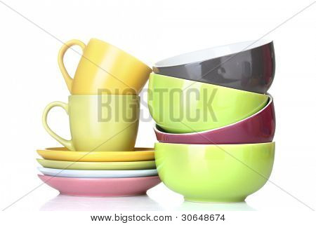 bright empty bowls, cups and plates isolated on white