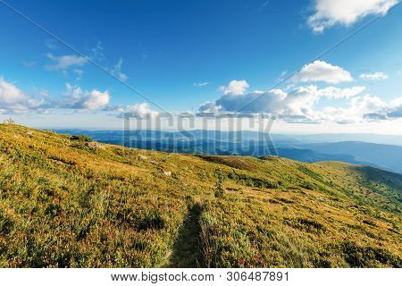 Path Down The Hill In To The Valley. Beautiful Summer Scenery With Idyllic Cloud Formations On A Blu