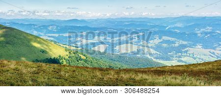 Panorama Of A Mountain Landscape. Beautiful View In To The Valley From The Top Of A Hill. Sunny Weat