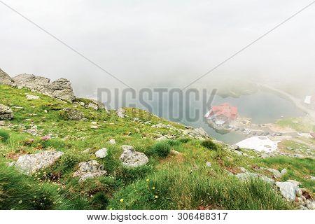 Lake Balea In Dramatic Weather. Beautiful Destination In Fagaras Mountain Of Romania. View Through C