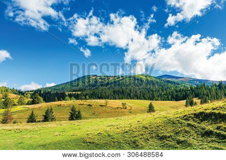 Wonderful Countryside In Mountain. Sunny Weather With Clouds Above The Ridge. Grassy Meadows And Spr