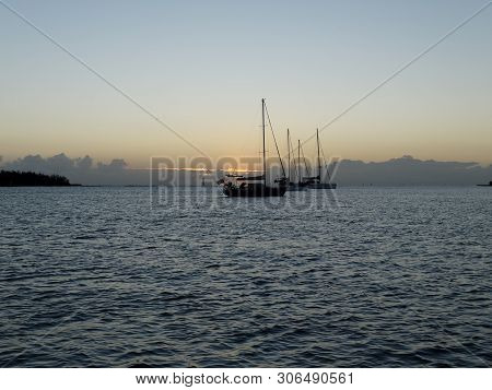 A Tropical Sunrise Seascape With Yachts At Anchor In The River Mouth With Calm Seas At Bundaberg, Qu