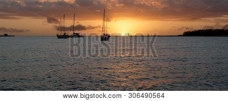 A Picturesque Tropical Stratocumulus Cloudy Nautical Sunrise Seascape Panorama With Moored Yachts At
