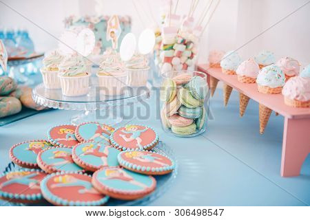 Rhythmic gymnastics Candy Bar. Tasty cupcakes, glazed rhythmic gymnastics shaped cookies, macaroons. Delicious sweet buffet.  Catering buffet for events. poster