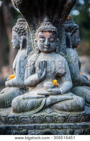 Close Up Buddhist Statue Kathmandu Nepal. Close Up Of Oblations Of Food And Flowers To Their Gods On