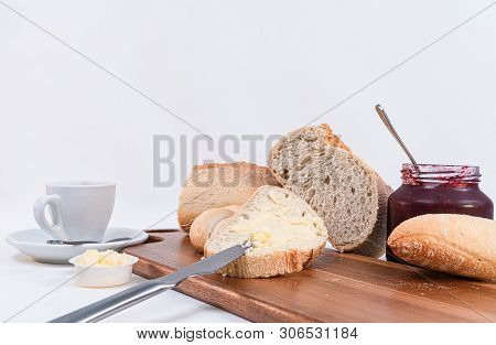 Cereal Bread Slices With Butter And Jar With Homemade Jam Closeup On Rustic Wooden Table. White Back