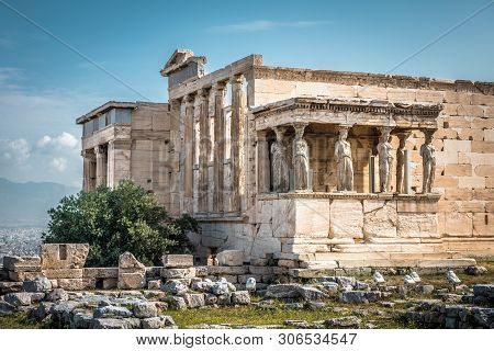 Erechtheion temple with Caryatid Porch on the old Acropolis, Athens, Greece. It is a famous landmark of Athens. Scenic view of Ancient Greek ruins. Beautiful antique Caryatids in the Athens center. poster