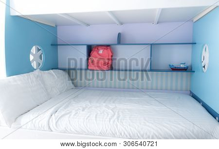 Pink Canvas Bag On The Blue Shelf Beside The Bed