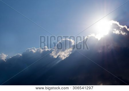 Sunbeam Of The Sun Behind The Clouds