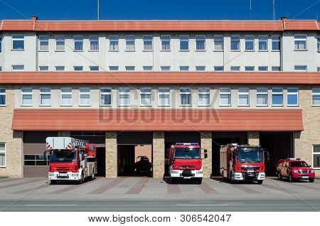 FIRE BRIGADE - Rescue vehicles in front of the fire station building in Kolobrzeg poster
